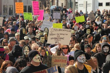 "Photo: TIME.com (Ohio Plain Dealer) People protest at the Jefferson County Courthouse in Steubenville, Ohio, Saturday, Jan. 5, 2013. Authorities investigating rape accusations against two high school football players in eastern Ohio launched a website Saturday as interest in the case balloons, an extraordinary step designed to combat the misperception ""that the football team runs the city,"" the city manager said."
