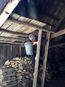 """This is the interior of our """"antique"""" (100 year old) sugar shack. I am worried the buckets will leach lead and make us craz(ier) and stupid(er). My husband likes old crap and says there's nothing to worry about!"""