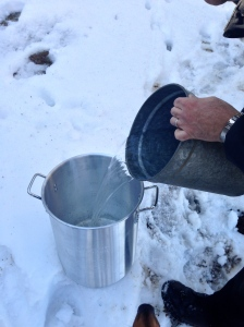 Getting ready to boil the sap. You have to do it outdoors unless you want the steam to take the wallpaper off your walls.